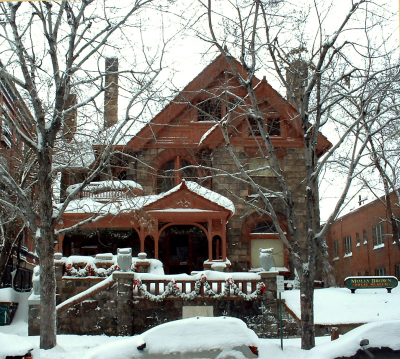 The Molly Brown house, showing it's roof covered is crisp Denver snow. Join our tour to hear the story of it's haunting!