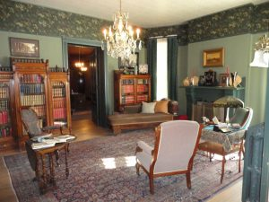 An interior room, decorated in the old fashioned style of stately Denver mansions